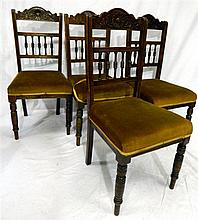 4 late Victorian dining chairs with spindles and carving