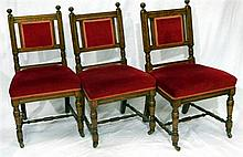 Three Victorian dining chairs with red upholstery