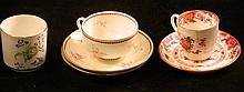 An antique Royal Worcester cup and two saucers together with a Royal Worcester beaker and an antique Cauldon demi tasse