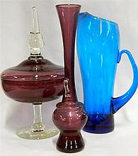Three pieces of coloured vintage glass including lemonade jug, vase and comport