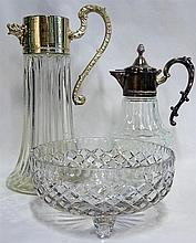 Two claret jugs with silverplate mounts with a crystal bowl
