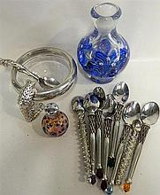 A small collection of contemporary spoons and glass.