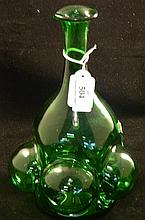 An unusual hand blown green glass carafe
