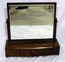 A George III mahogany bow front dressing table mirror