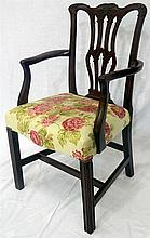 A Georgian Chippendale walnut armchair with floral fabric