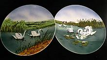 A pair of ceramic swan wall plaques