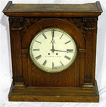 A mid 19th century French oak cased wall clock