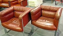 A 'Poltrona Frau' leather and chrone two seater settee and two arm chairs