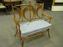 A Victorian bamboo two seater settee with buttoned cushion