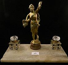 A marble set desk set with gilded spelter figure surrounded by two glass inkwells