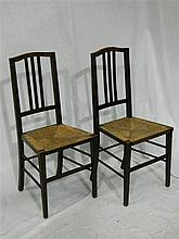 A pair of timber side chairs with wicker seats