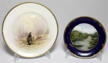 A Wedgwood plate together with a Royal Doulton plate (2)