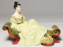 A Royal Doulton figurine 'At Ease',