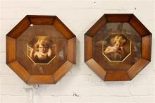 An unusual pair of Parkinson photographic prints of cherubs in timber octagonal frames