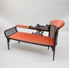 A Edwardian Chaise Longue with decorative fretwork back