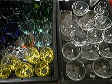 Large selection of drinking glasses, clear and coloured