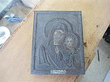 An Icon on wooden backing
