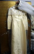 Norman Hartnell  silk wedding gown with headdress with guipure lace decoration