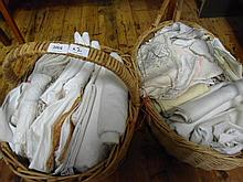 Two boxes containing Damask linen table cloths, napkins and embroidered cloths