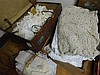 Four boxes containing various  crochet bed spread, supper cloths, various laces