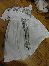 Three cotton dresses, including two christening gowns