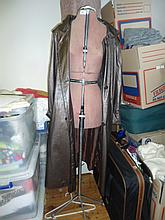 A Taille dress makers mannequin on metal stand with Mac