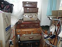 A group of vintage suitcases and contents