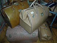 A group of vintage style Gladstone bags and contents