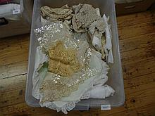 A box of linen and lace collars