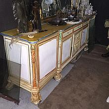 An ornately carved and painted sideboard