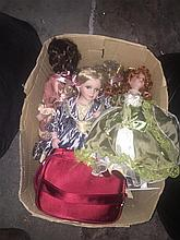 A carton of period style dolls