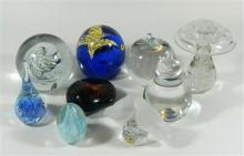 A collection of nine paperweights, including signed examples