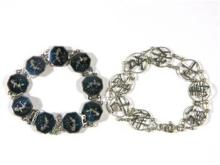 Two Sterling Silver Bracelets, one with Chinese Symbols the other with Black Engraved Figures