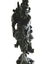 A Chinese Rosewood Figure of a Sage