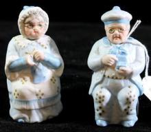 A pair of continental Bisque male and female nodding figures
