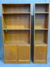 Two 1960s Parker style companion bookcases having open shelving and cupboard doors