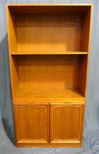 A 1960s Parker style open shelve adjustable bookcase with cupboard to base.