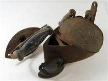A collection of five iron remnants including a child's billet iron