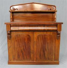 A mid 19th Century mahogany chiffonier having a single drawer above two cupboard doors with an architectural back and applied moulding
