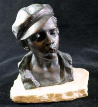 A bronze bust of a young boy smoking on marble base