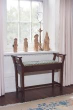 A music seat (AF), together with four carved saintly ornaments and a Florentine table lamp base