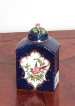 A Royal Worcester lidded tea caddy, 11.5cm in height