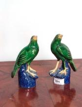 A pair of glazed pottery bird ornaments, each 17cm in height