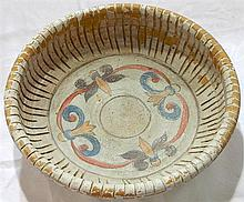A large painted terracotta basin