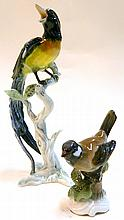 A Kaiser porcelain figure of a bird (AF), together with a Rosenthal porcelain bird figure 'Handgemalt'