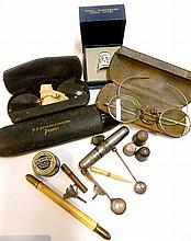 A collection including antique spectacles, sterling silver mustard spoon, Dorcas thimbles, sterling silver miniature funnels, and an...