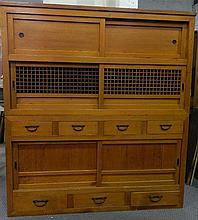 A vintage Japanese two height boxwood cabinet