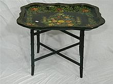 A papier mache tray on stand