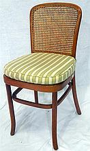 A set of eight cane chairs