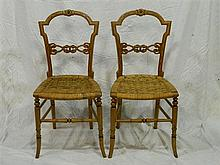 A pair of oak side chairs with wicker seating
